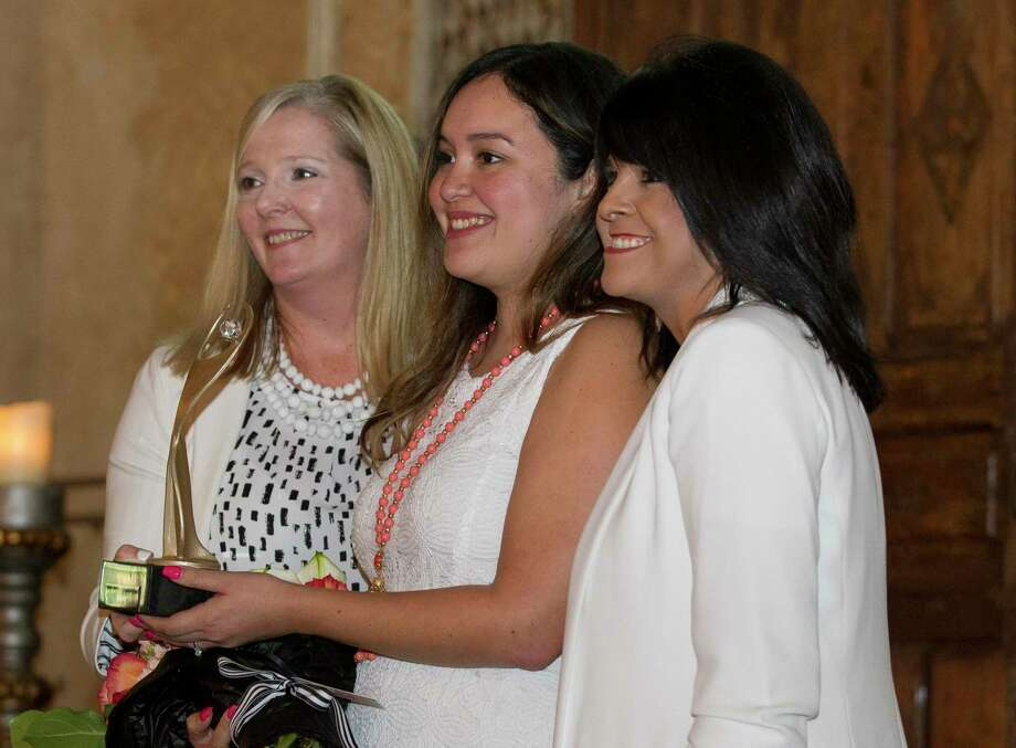 Christina Tejeda Cervantez, daughter of Marlen Tejada, accepts the Athena Leadership Award on behalf of her mother during a luncheon at Madera Estates, Thursday, July 25, 2019, in Conroe. The annual award luncheon, hosted by the Conroe/Lake Conroe Area Chamber of Commerce, recognized several women leaders in Montgomery County and featured speaker Danna Hoyt, president of Sam Houston State University. Photo: Jason Fochtman, Houston Chronicle / Staff Photographer / Houston Chronicle