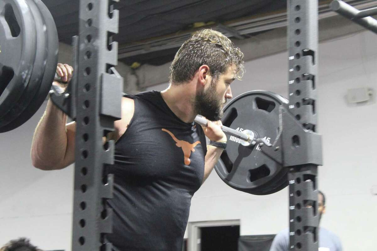 Samuel Cosmi does a workout at Armed Forces in Atascocita. Cosmi plays at the University of Texas and is an Atascocita alumni