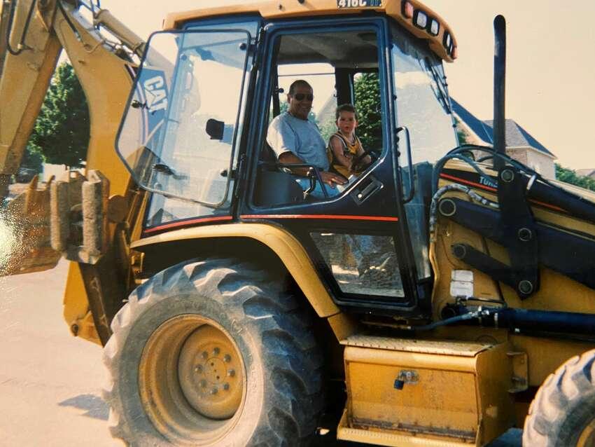 Robert Marini, Sr. with one of his grandsons, Tyler Marini in 2005. Marini, Sr., died April 22, 2020.