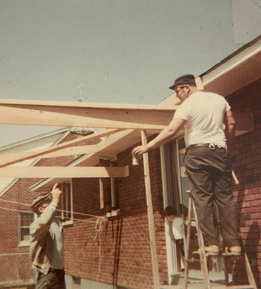 Residential builder Robert Marini, Sr., right, on a job site in approximately 1970.
