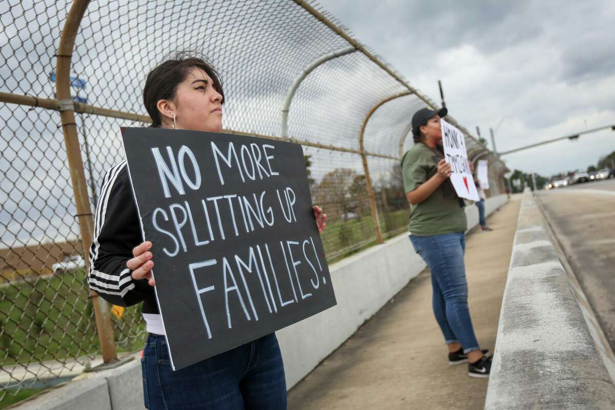 Conroe resident Andreina Gonzalez participates in the Immigration and Customs Enforcement protest on Feb. 26, 2017, on the North Loop 336 overpass above Interstate-45 in Conroe.