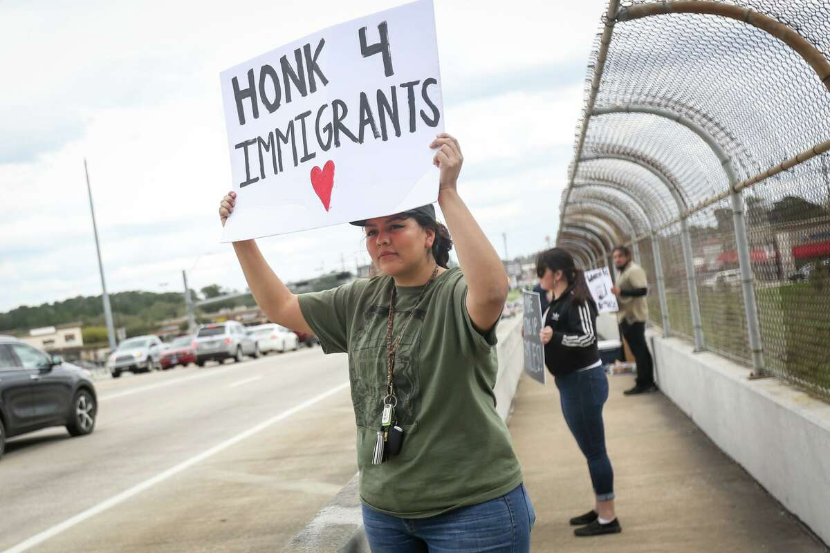 Sandra Elias, a director with Minorities Together Community Services, participates in the Immigration and Customs Enforcement protest on Feb. 26, 2017, on the North Loop 336 overpass above Interstate-45 in Conroe.