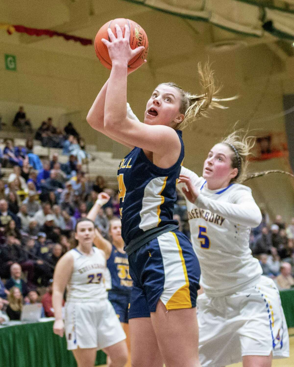 Sacred Heart women's basketball signee Kelsey Wood of Averill Park grabs a rebound in front of Queensbury senior Hailey Ballard in the Section II Class A finals at Hudson Valley Community College in Troy, N.Y., in March.
