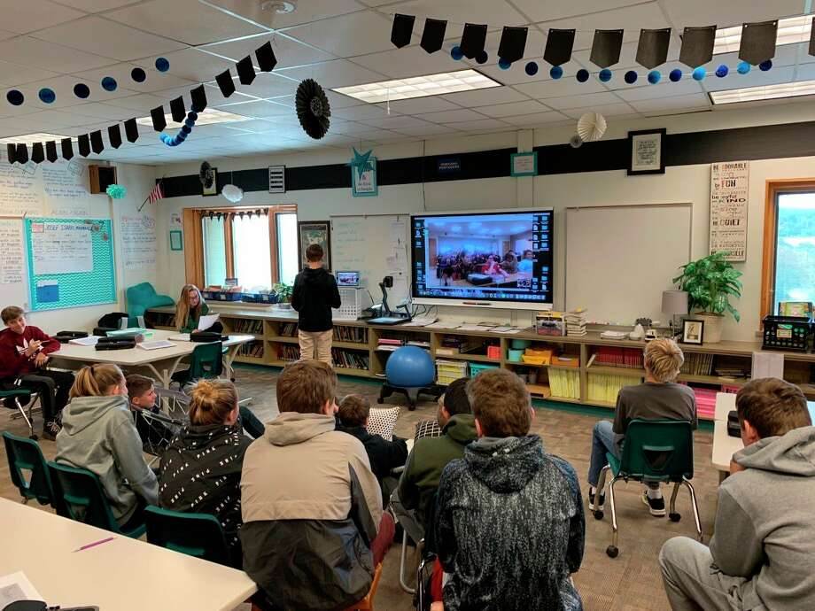 A student gives a presentation in a classroom at Onekama Consolidated Schools in 2019. School officials are watching what will transpire at the May 15 MichiganConsensus Revenue Estimating Conference in Lansing, which will determine school funding for the rest of this year and next year. The COVID-19 pandemic has impacted the economy, causing a loss of state revenue that could impact the money schools receive in per pupil funding. (File photo)