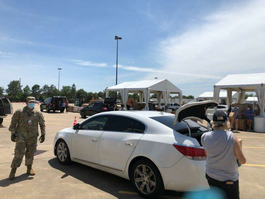 The mega food distribution on April 29, hosted by Houston Food Bank and Cy-Hope in the Berry Center parking lot, served 7,500 meals to families in the wake of the COVID-19 pandemic. Photo: Lynda Zelenka