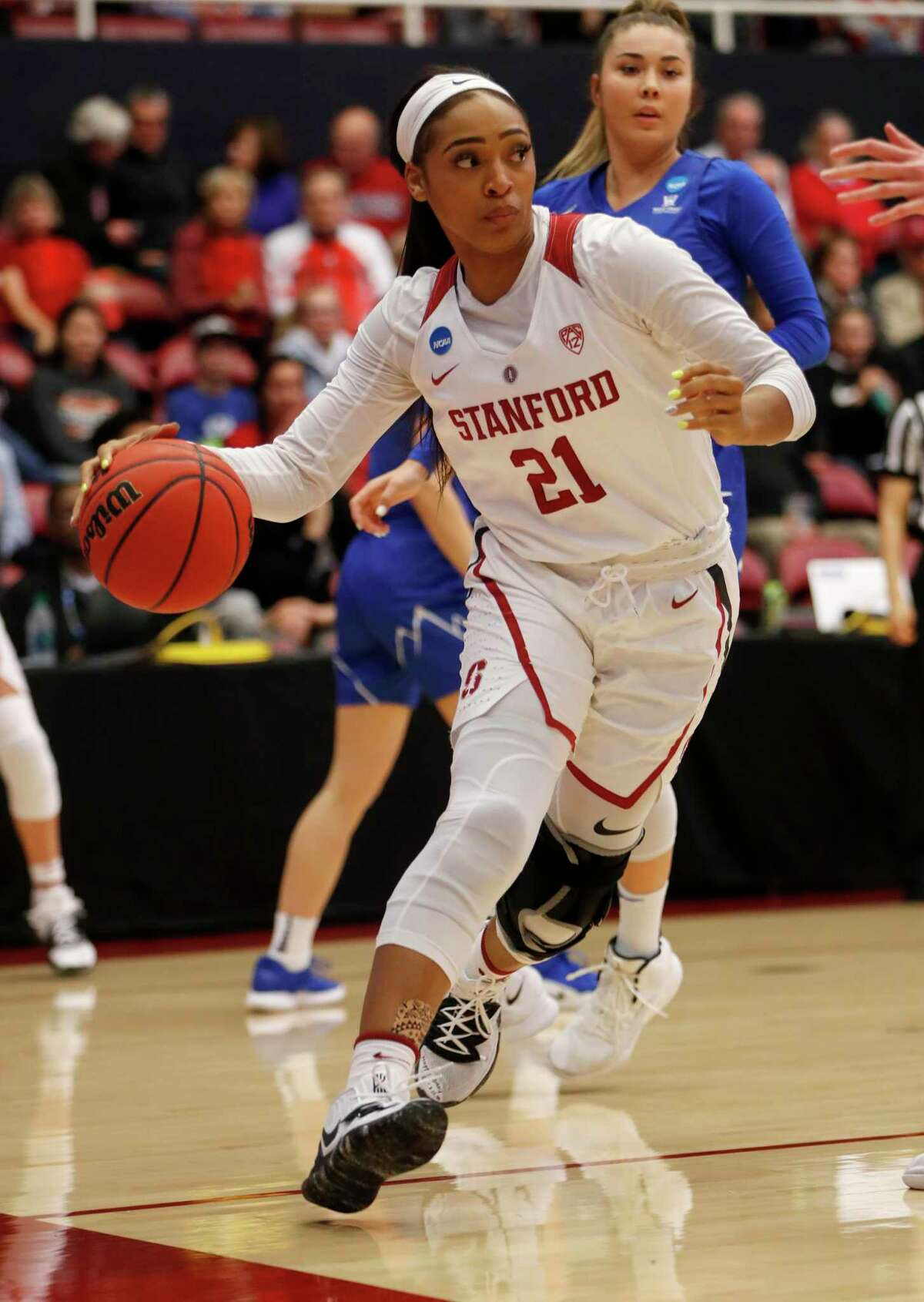 STANFORD, CA - MARCH 25: Stanford's DiJonai Carrington (21) dribbles against BYU in the first quarter for their 2019 NCAA Division I second round basketball game at Maples Pavilion in Stanford, Calif., on Monday, March. 25, 2019. (Photo by Nhat V. Meyer/MediaNews Group/The Mercury News via Getty Images)