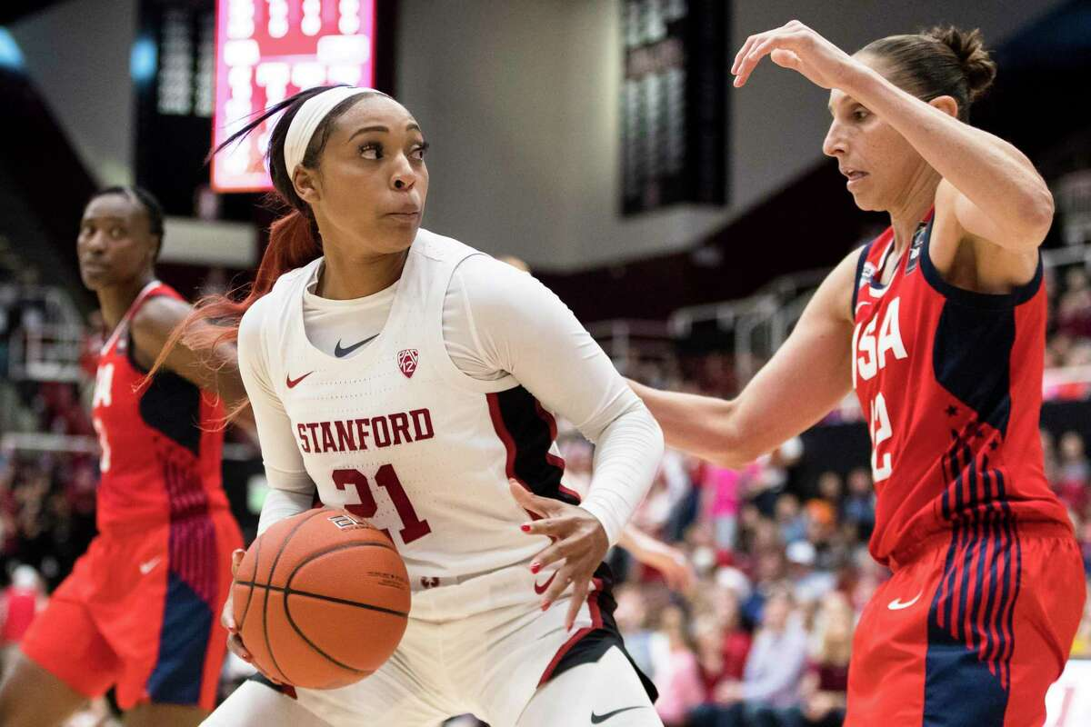 Stanford guard DiJonai Carrington (21) dribbles as Team USA guard Diana Taurasi, right, defends in the fourth quarter of an exhibition women's basketball game last year in Stanford, Calif.