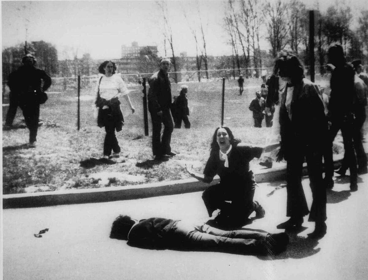 Mary Ann Vecchio screams as she kneels by the body of a student lying face-down on the campus of Kent State University in Kent, Ohio, May 4, 1970. National Guardsmen had fired into a crowd of mostly student antiwar demonstrators, killing four.