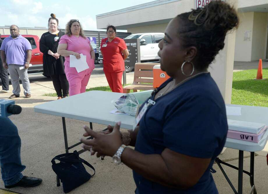 Nurse LaTasha Mayon describes the procedure for testing that will take place at the drive-thru testing unit for COVID-19 at Jack Brooks Regional Airport Monday, which will open Tuesday morning. They expect to test roughly 25 people per day and already have a full testing schedule for their opening day. The testing center will service residents throughout several Southeast Texas counties.   Photo taken Monday, March 23, 2020 Kim Brent/The Enterprise Photo: Kim Brent / The Enterprise / BEN