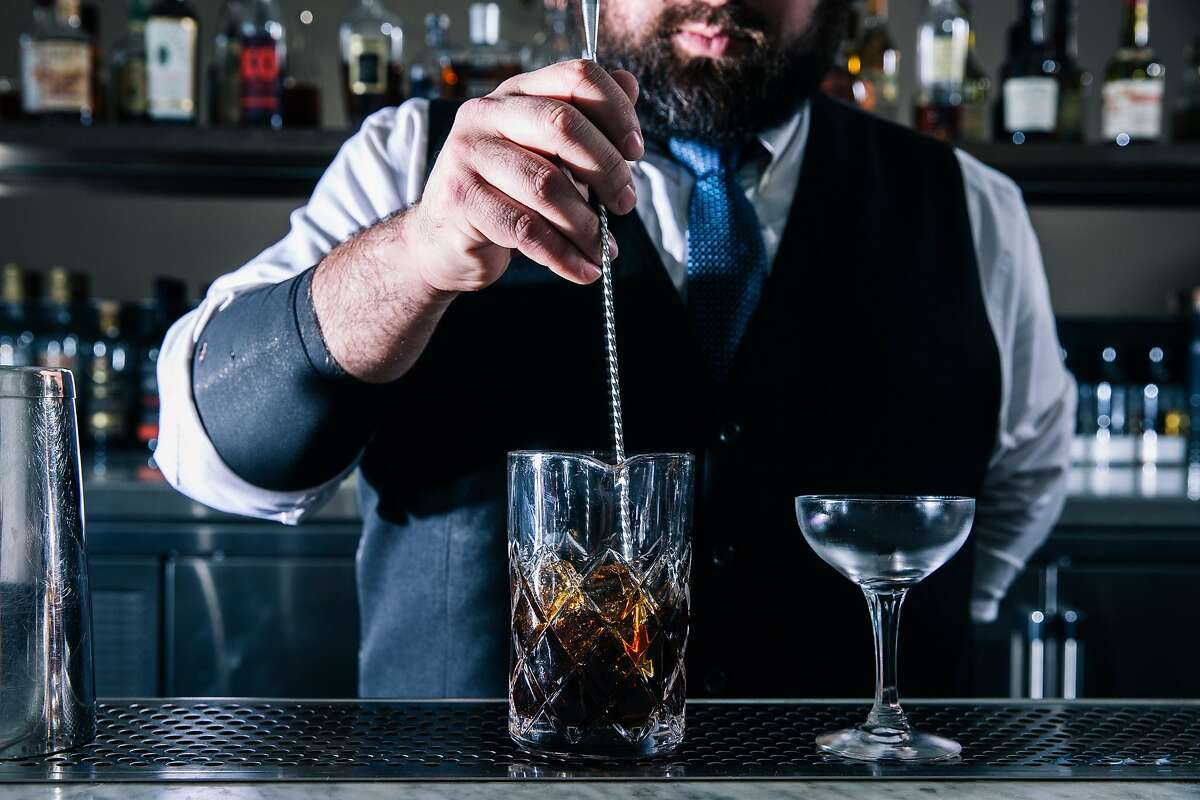 Ronnie Arevalo, lead bartender at Commis' CDP Bar, mixes a Medianoche cocktail in Oakland, Calif. on Wednesday, March 4, 2020.
