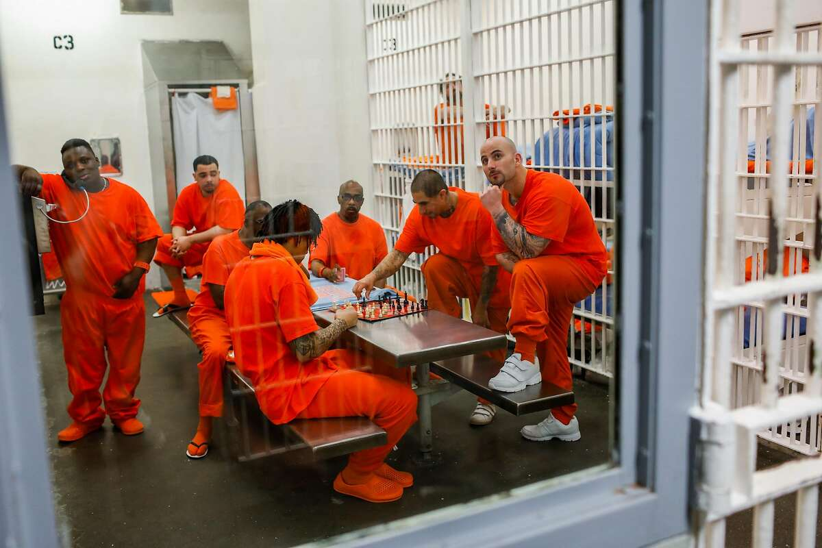 Inmates spend time in the recreational area of their cells at the County Jail 4 in the Hall of Justice in San Francisco, California, on Thursday, Nov. 1, 2018.