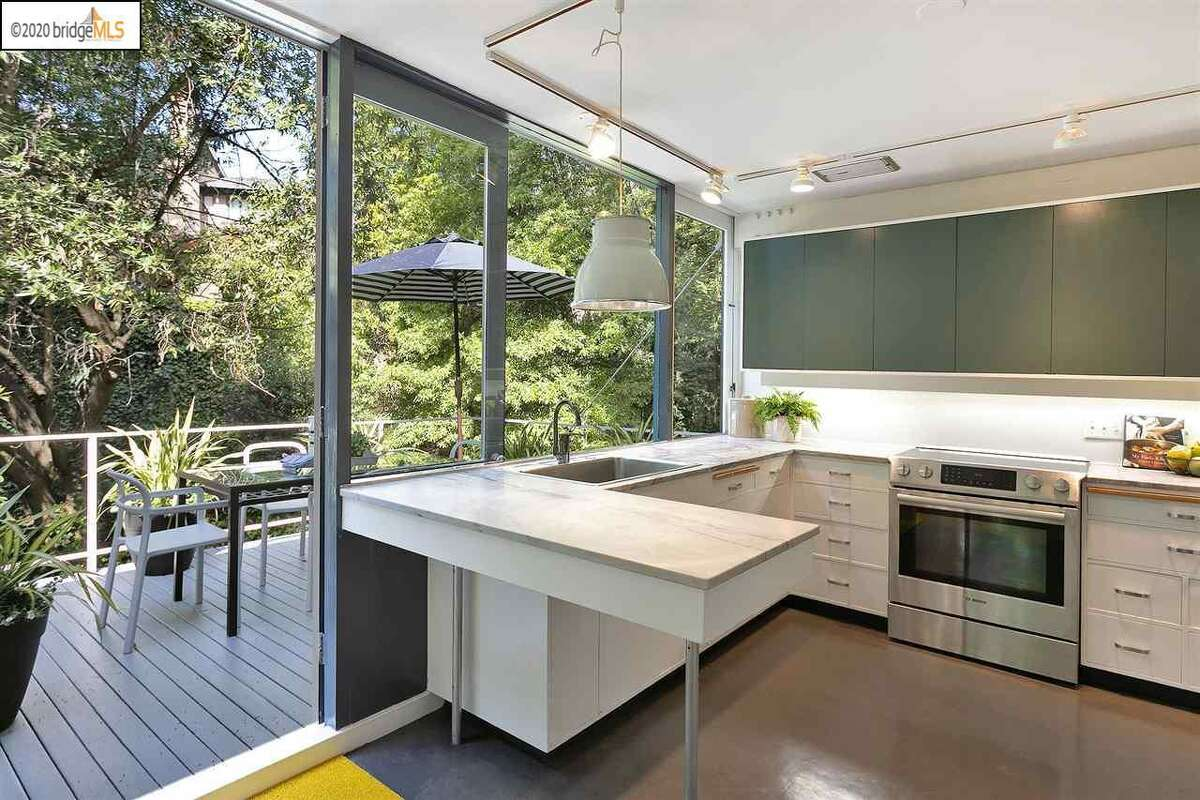 The small kitchen leads out to a deck.