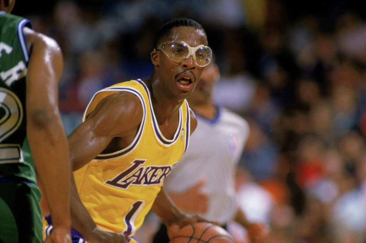 Wes Matthews of the Los Angeles Lakers dribbles the ball during a game against the Dallas Mavericks in 1987.