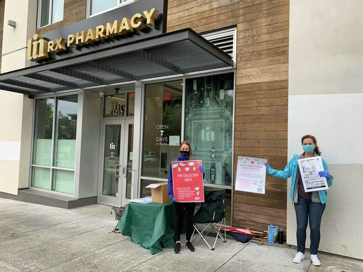 UCSF pharmacy students Adriana Gardner, right, and Marianne Duran pictured during a personal protective equipment donation drive at the TIN Rx pharmacy in San Francisco.
