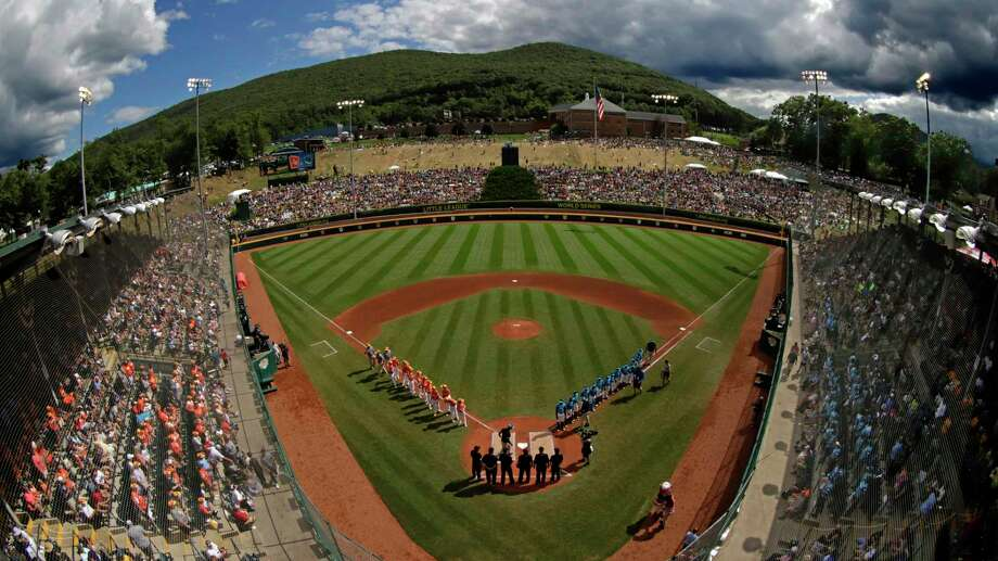 In this Sunday, Aug. 25, 2019, file photo, River Ridge, Louisiana, lines the third baseline and Curacao lines the first baseline during team introductions before the Little League World Series Championship game at Lamade Stadium in South Williamsport, Pa. The 2020 Little League World Series and the championship tournaments in six other Little League divisions have been canceled because of the new coronavirus pandemic. Photo: Gene J. Puskar / Associated Press / Copyright 2019 The Associated Press. All rights reserved