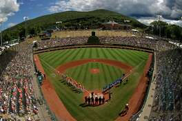 In this Sunday, Aug. 25, 2019, file photo, River Ridge, Louisiana, lines the third baseline and Curacao lines the first baseline during team introductions before the Little League World Series Championship game at Lamade Stadium in South Williamsport, Pa. The 2020 Little League World Series and the championship tournaments in six other Little League divisions have been canceled because of the new coronavirus pandemic.