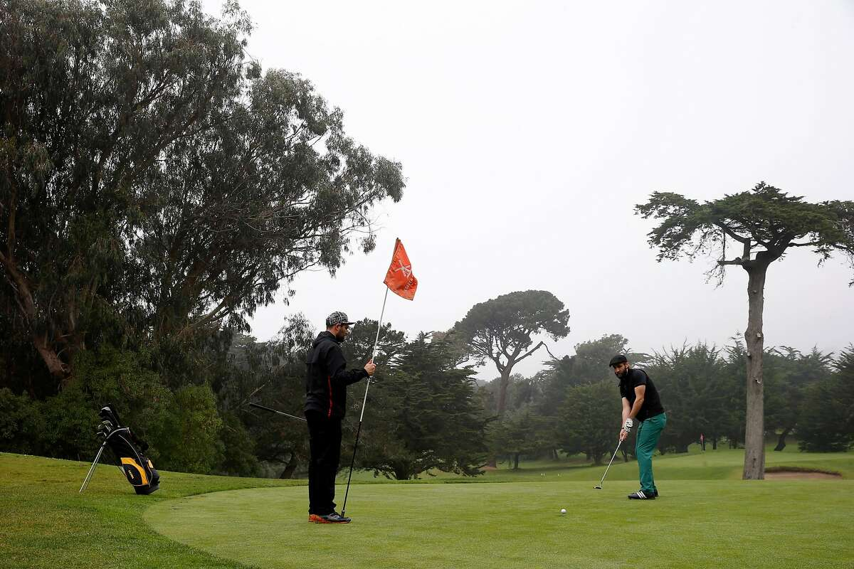 From left: Daniel Rotstein and Daniel Hunter play at Hole 2 at the Golden Gate Park Golf Course, Tuesday, Jan. 16, 2018, in San Francisco, Calif.