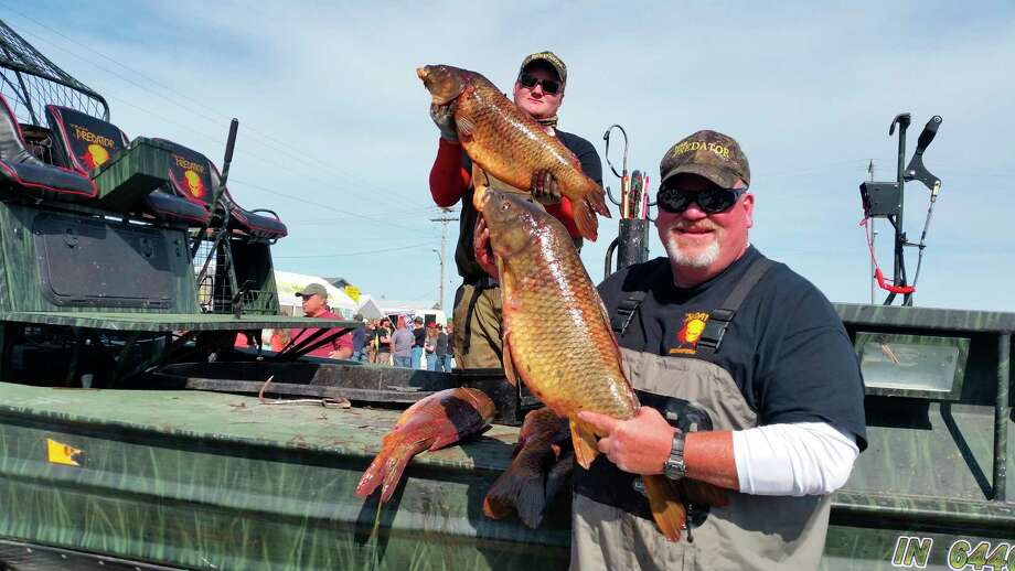 Bowfisherman show off their catches during a past Caseville Bowfishing Championship. This year's event has been canceled due to the coronavirus pandemic. (Bob Easterbrook/Submitted Photo)