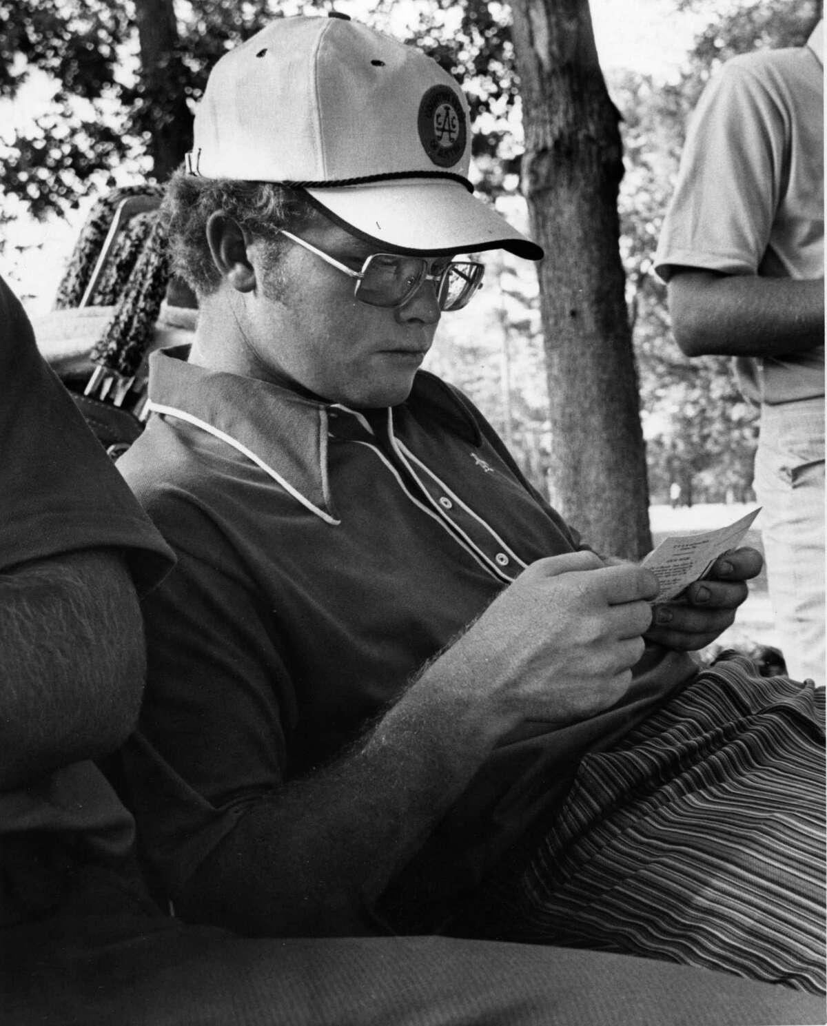 05/1974 Houston Open Golf - Quail Valley Golf Club. Tom Kite checks his scorecard.