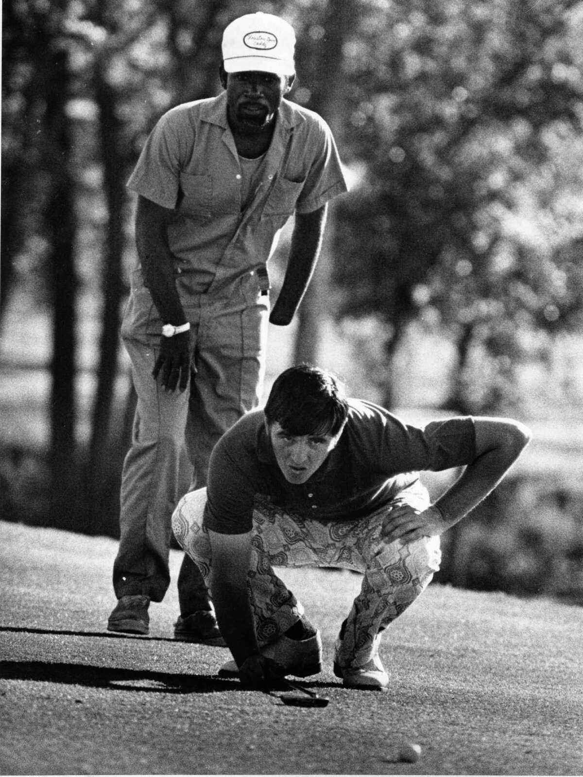 05/03/1973 - Houston Open Golf - Quail Valley Golf Club - Mike Hill lines up putt on the 18th green.