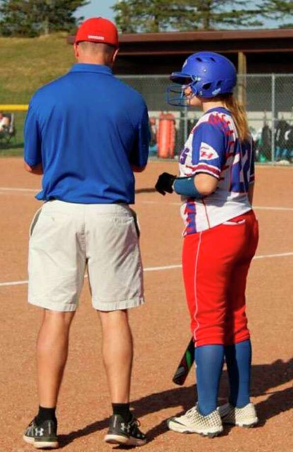 Chippewa Hills' Erin Spaugh confers with coach DJ Newman during a game this season. (Courtesy photo)