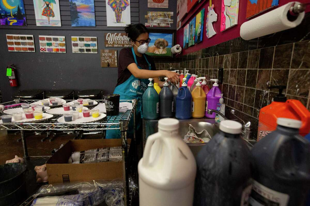 Marylou Vasquez prepares paint for online orders at Pinot's Palette Wednesday, April 29, 2020, at Sugar Land Town Square in Sugar Land. Vasquez's sister, Diana Mojica, owns the store and is getting ready for the retail re-open on Friday, but still wants to focus on online orders.