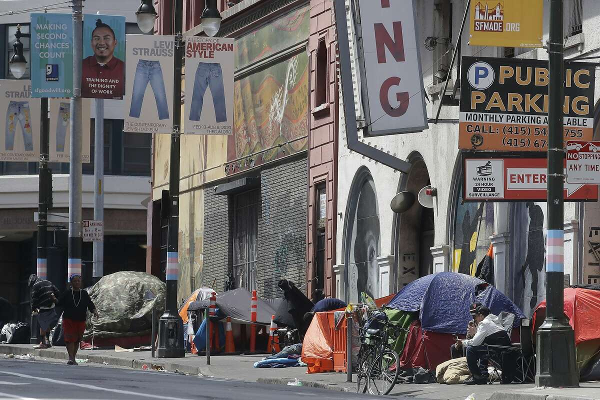 Tents line a sidewalk on Golden Gate Avenue in San Francisco, Saturday, April 18, 2020. California is on its way to acquiring 15,000 hotel rooms to house the homeless during the pandemic, said Gov. Gavin Newsom on Saturday as he reminded people to stay indoors while outbreaks continue to crop up throughout the state. (AP Photo/Jeff Chiu)