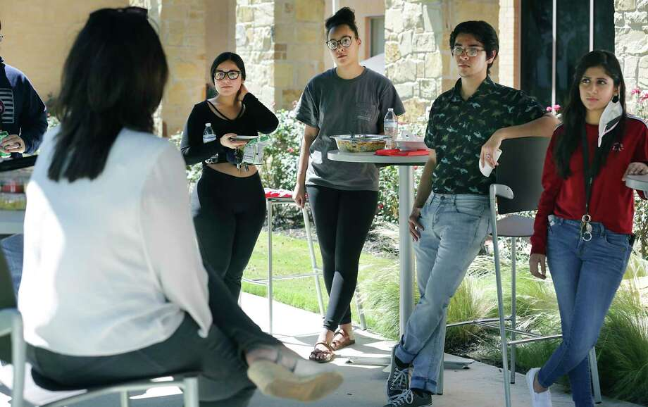 Mari Fuentes-Martin, the Texas A&M University San Antonio vice president for student success and engagement, talks with students who chose to stay in dorms at a snack social Thursday. Photo: Bob Owen, Staff-photographer / San Antonio Express-News / ©2020 San Antonio Express-News
