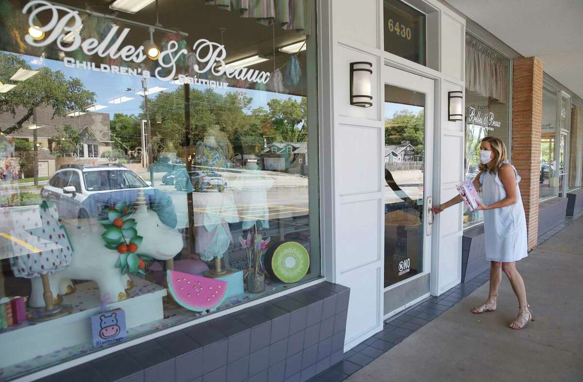 Christen Wommack, owner of Belles & Beaux Children's Boutique, is preparing to reopen the store Friday.
