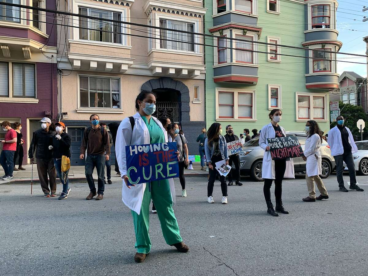A group of protestors gathered in front of San Francisco Mayor London Breed's house on Thursday, Apri 30, 2020 alleging San Francisco has failed to meet deadline for leasing enough hotel rooms to house the homeless during the coronavirus pandemic.