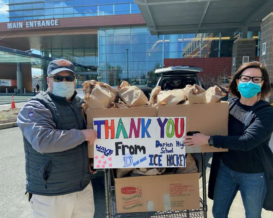 Stephanie Riggio and Darien High School girls hockey coach Jamie Tropsa recently delivered lunches to staff at Stamford Hospital courtesy Mama Carmela's deli in Darien. Riggio coordinated team donations to schedule four days of lunch deliveries and is working on a fifth. Photo: Contributed