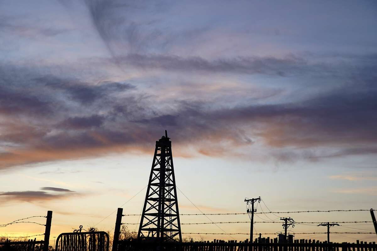 Sunsets behind a vintage Oil Derrick in Odessa, Texas on Tuesday, April 28, 2020.