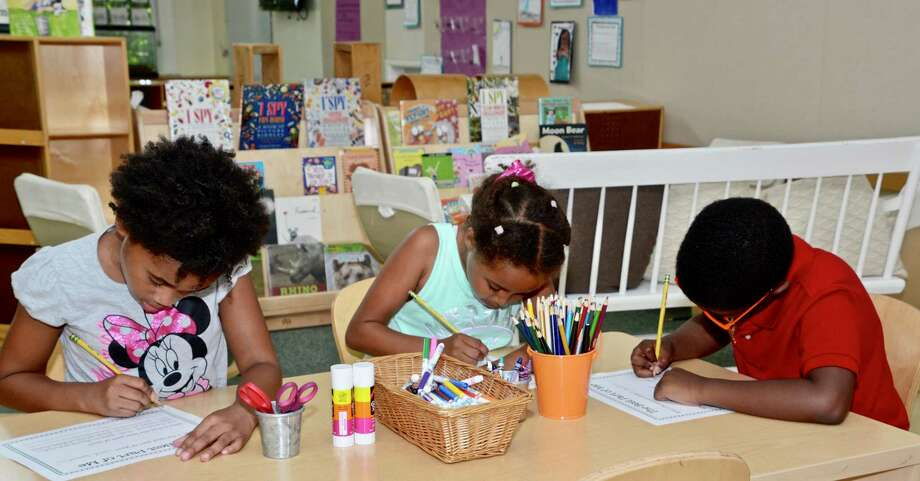 The Horizons Program at New Canaan Country School recently sought support for its annual Giving Day, which it held May 20. Donations were accepted for it through this date. Students in the Horizons Junior Program previously do some work in a classroom. Photo: Contributed Photo