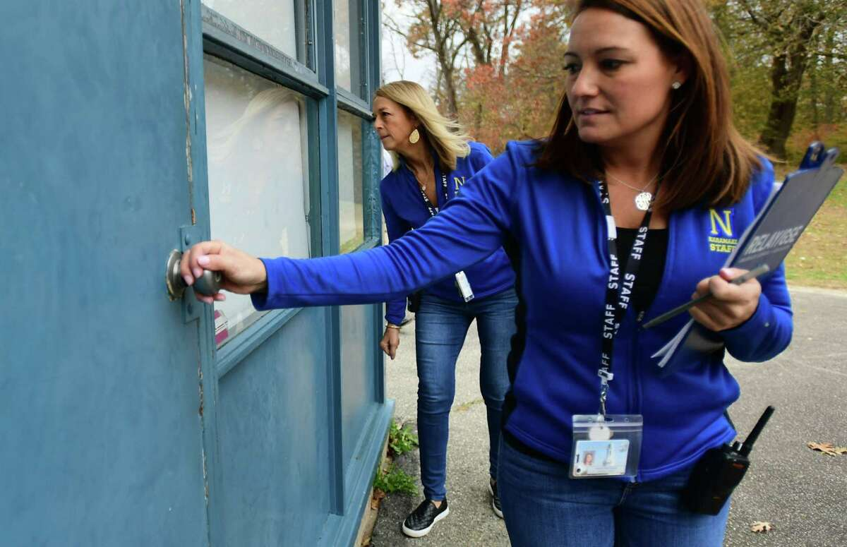 Naramake Elementary School Site Director Shannon Roman, right, and Principal Jane Wilkins work through the school to make sure doors are locked and blinds closed during a drill on Nov. 22, 2019, at the school in Norwalk. In the post-coronavirus world, pandemic drills may become a regular part of school life like lockdowns and shelter-in-place drills.