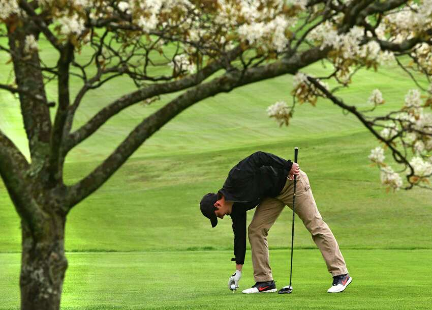 Gary Lennox of Troy tees up his golf ball on the first hole on opening day at Frear Park Municipal Golf Course Friday, May 1, 2020 in Troy, N.Y. The golfers are required to adhere to social distancing requirements to limit the possible spread of COVID-19. (Lori Van Buren/Times Union)