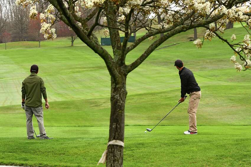 Gary Lennox of Troy, right, gets ready to his his first tee shot as his friend Khach Karayan of Troy watches at left on opening day at Frear Park Municipal Golf Course Friday, May 1, 2020 in Troy, N.Y. The golfers are required to adhere to social distancing requirements to limit the possible spread of COVID-19. (Lori Van Buren/Times Union)
