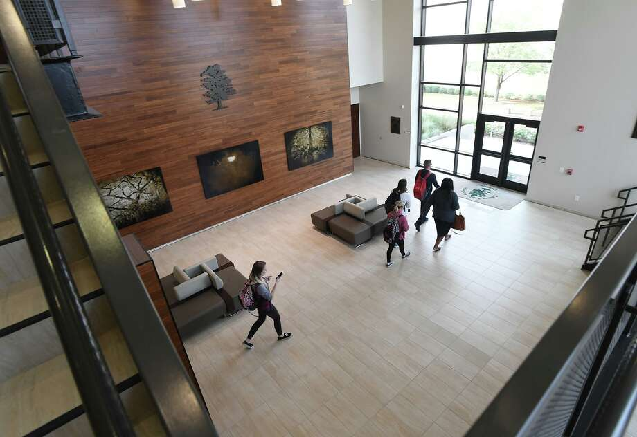 Students walk through the Nursing Building at Lamar State College Orange on Tuesday. The school will celebrate its 50th anniversary during a celebration on campus today at 2.  Photo taken Tuesday, 1/22/19 Photo: Guiseppe Barranco/The Enterprise, Photo Editor / Guiseppe Barranco ©