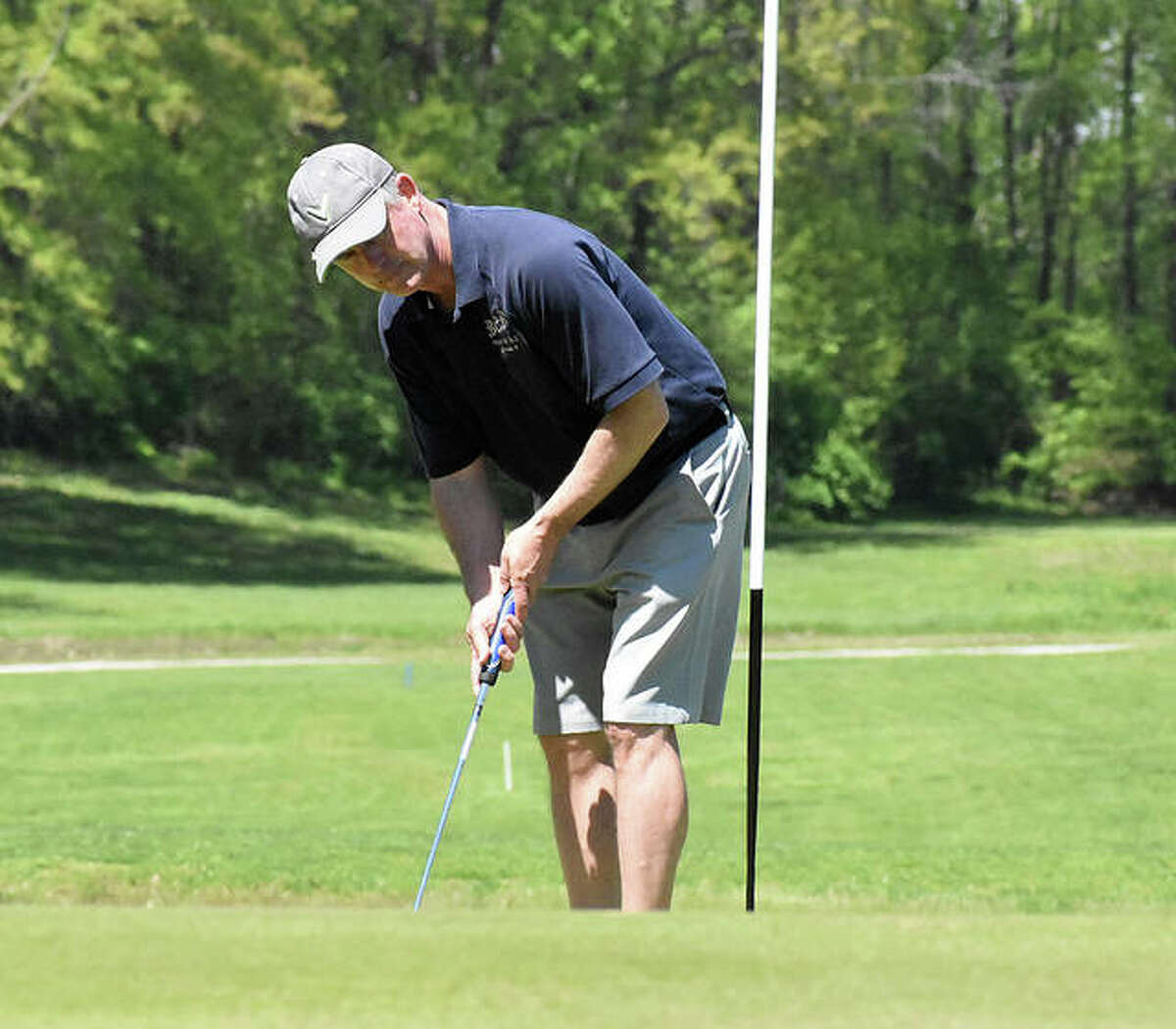 Edwardsville resident Dave Wasmuth reacts to his putt on the No. 9 hole at Oak Brook Golf Club on Friday.