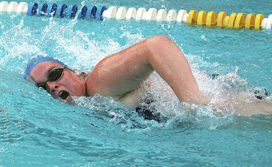 Rachel Paule swims the freestyle in a meet last summer against Collinsville Aqua Park. Paule, a senior at Alton High, will swim next season at Illinois College. Photo: Pete Hayes | The Telegraph