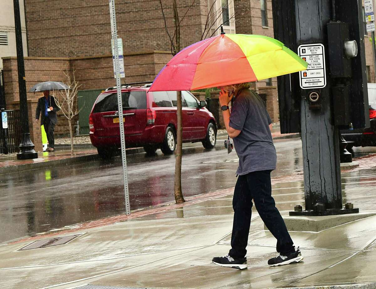 A pedestrian walks up New Scotland Ave. with an umbrella during a steady rain on Friday, May 1, 2020 in Albany, N.Y. (Lori Van Buren/Times Union)