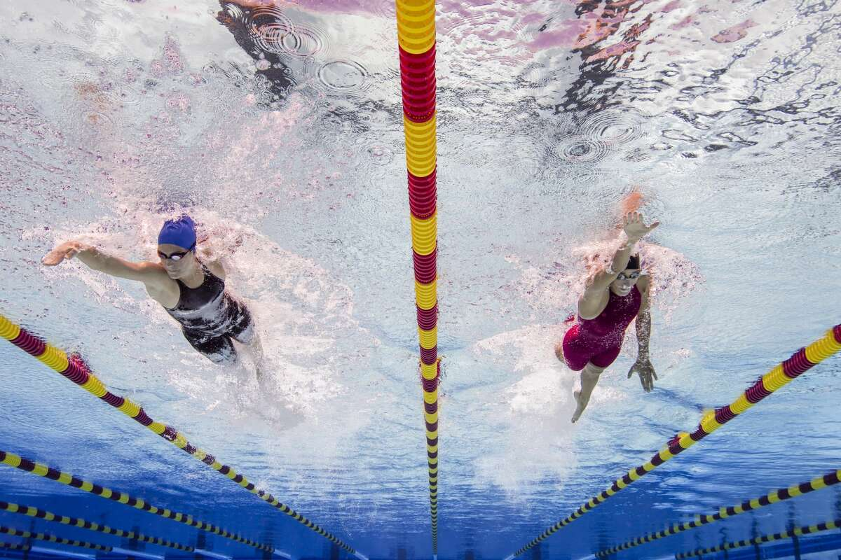 FILE PHOTO: Two swimmers separated by lane lines.
