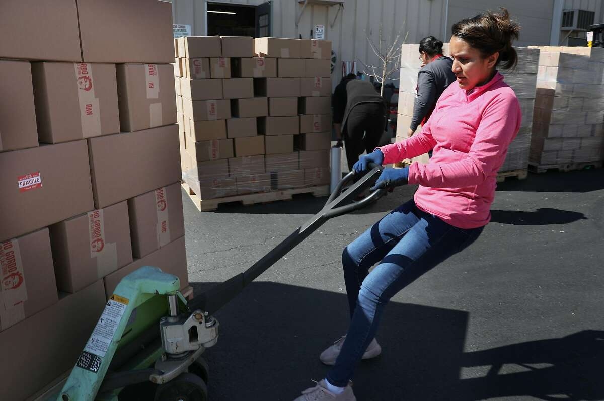 Shipping manager Adriana Barajas moves pallets of Rancho Gordo beans prepared for pickup by the Rancho Gordo factory in Napa in early March.