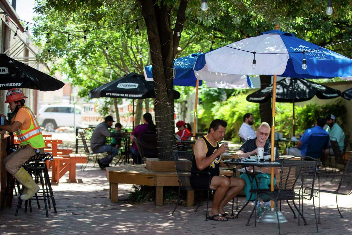 Patrons eat outside on the patio at Earl Abel's on May 1, 2020. Earl Abel's is reopening for patio-only table service following restrictions on restaurants being lifted by Gov. Greg Abbott.