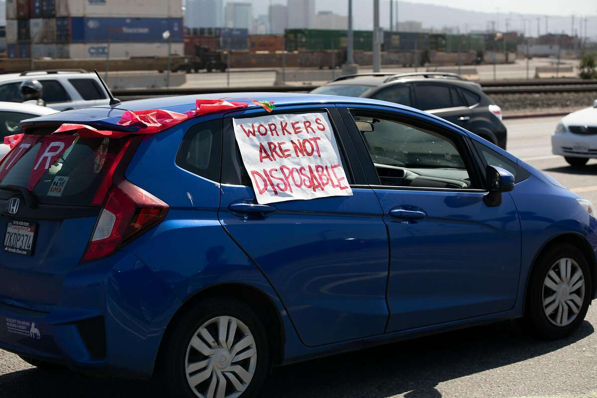 Workers and protesters gathered at the Port of Oakland on May Day, calling for protective gear for essential workers and free healthcare for all.
