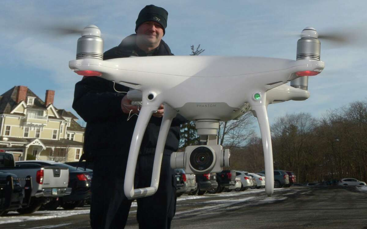 Westport Police Capt. Ryan Paulsson deploys the department's drone for a demonstration Wednesday, January 3, 2018. The town of Westport pulled plans to launch a drone program to monitor crowds in an effort to help prevent the spread of the coronavirus. The concept of using drones to watch over communities has drawn mixed reactions.