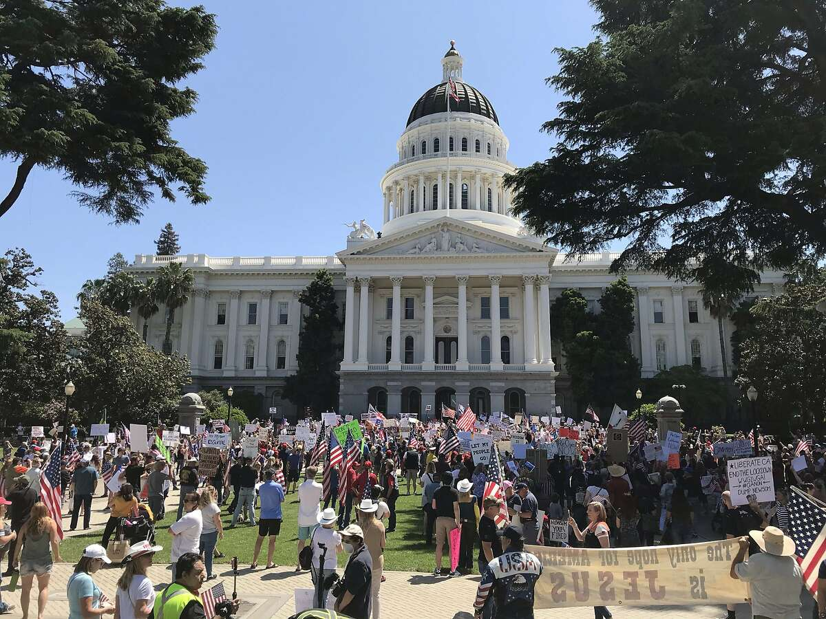 Protestors gathered at the state Capitol on May 1, 2020, to demand that Gov. Gavin Newsom reopen California, which is under a statewide stay-at-home order to slow the spread of the coronavirus.