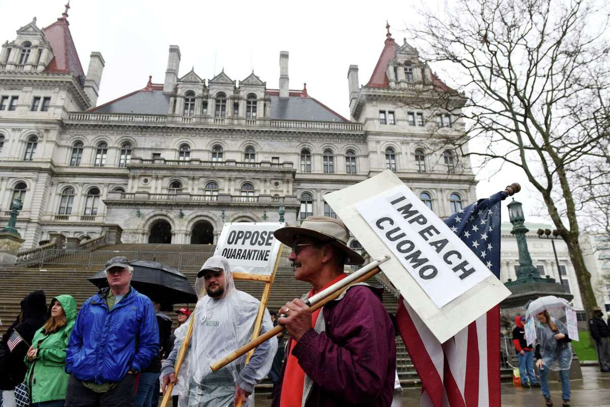 Protesters upset with state coronavirus lockdown measures rally outside the Capitol on Friday, May, 1, 2020, in Albany, N.Y. (Will Waldron/Times Union)