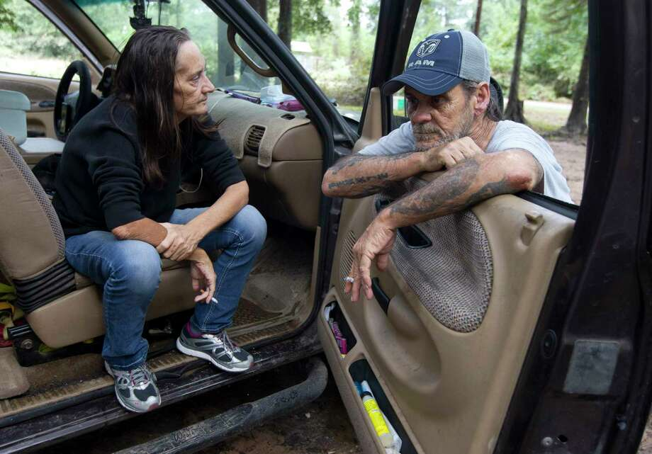 "Margret Cameron takes in a moment beside her fiancé, Bennie Lee, after returning to her home after it was flooded with five and a half feet of water from Tropical Depression Imelda, Friday, Sept. 20, 2019, in Splendora. Margret, Bennie and his daughter have stayed in their truck a few houses down for the last two days. ""We rebuild, come back, rebuild and come back,"" Bennie Lee said. ""You just start to wonder what's the point after a while."" This image was a part of Jason Fochtman's winning entry for Texas APME Star Photojournalist of the Year. Photo: Jason Fochtman, Houston Chronicle / Staff Photographer / Houston Chronicle"