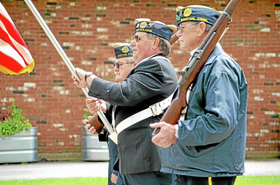 In 2015, participants in the Bantam Memorial Day parade marches along Bantam Road to the Bantam Cemetery. This year's parade has been canceled because of the coronavirus pandemic. Photo: File Photo / Hearst Connecticut Media
