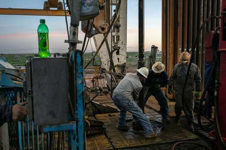 Workers at Latshaw Drilling's Rig 19 near Stanton, Texas, on April 24, 2020. As the world is stuck with too much oil, and too little demand, this area is experiencing a double economic shock not seen in modern times. (Tamir Kalifa/The New York Times)